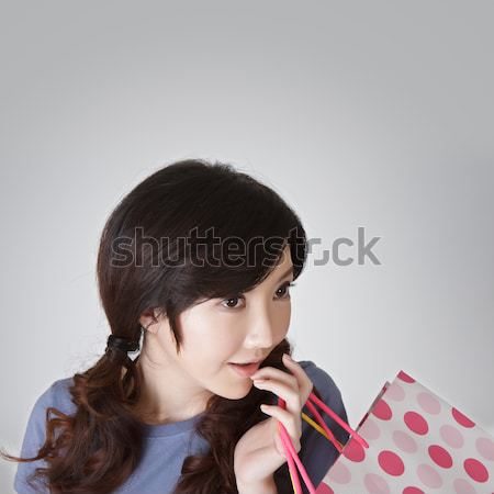Surprised shopping woman Stock photo © elwynn