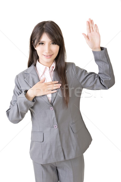 Asian business woman give you a gesture of swear Stock photo © elwynn