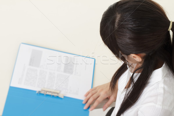 Stock photo: Business woman reading report