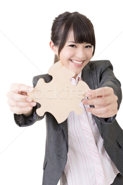 Asian business woman holding a piece of puzzle Stock photo © elwynn