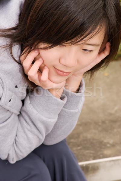 Femme seuls asian extérieur s'asseoir Photo stock © elwynn
