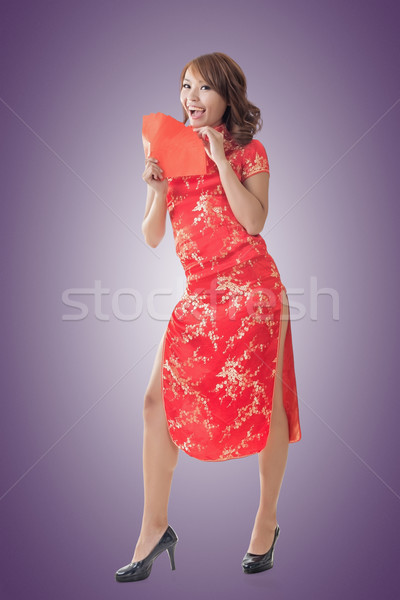 Chinese woman dress cheongsam and hold red envelope Stock photo © elwynn