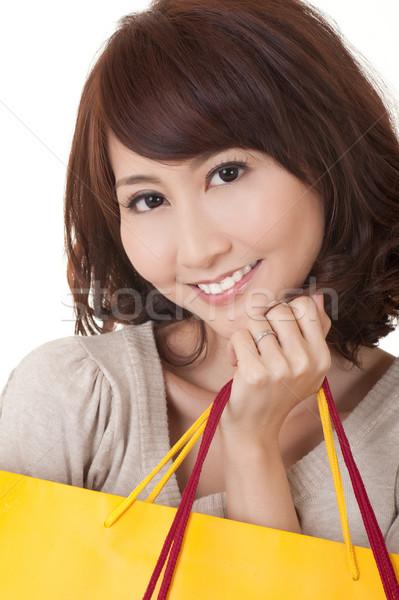 Stock photo: Smiling shopping woman