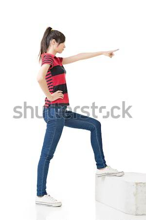 Asian woman pointing with hand Stock photo © elwynn