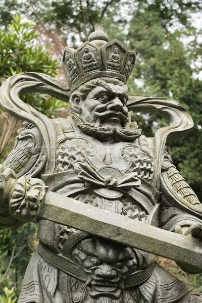 Aged asian god statue Stock photo © elwynn