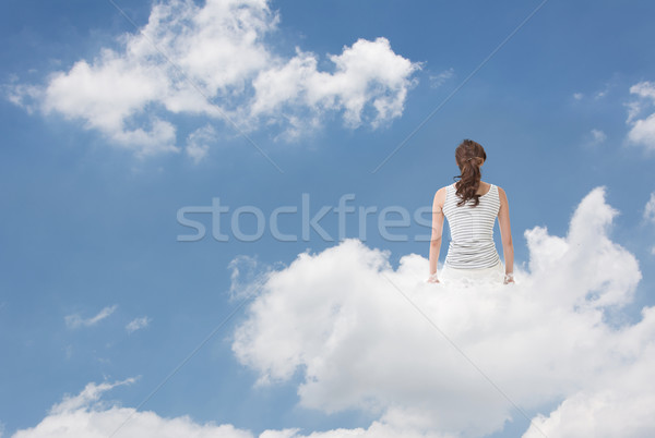 Brunet woman sit on clouds Stock photo © elwynn