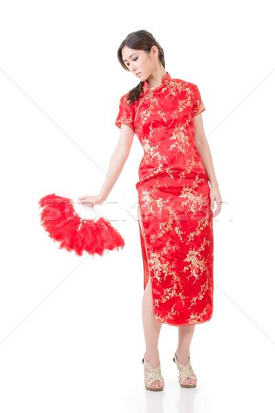 Beautiful asian young woman with fan in cheongsam Stock photo © elwynn