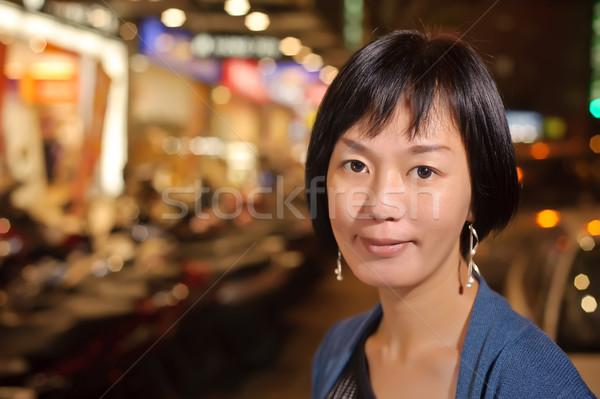 Smiling Asian woman Stock photo © elwynn