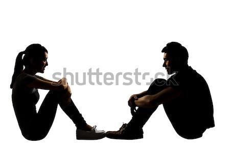 Fiatal pér szemtől szembe ül föld teljes alakos portré Stock fotó © elwynn