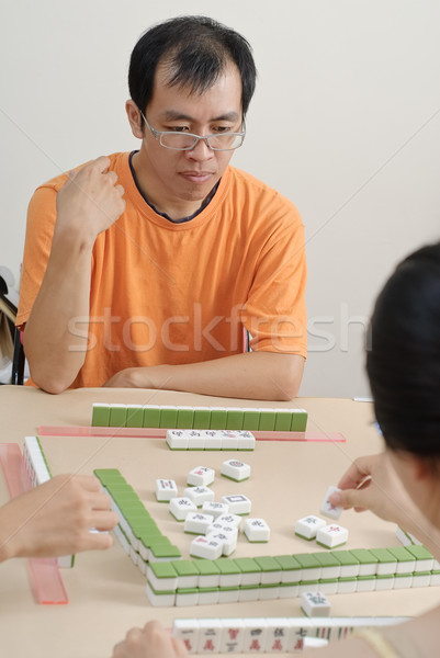 Chinese man play Mahjong Stock photo © elwynn