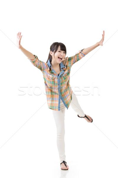 Smiling happy asian woman full length portrait Stock photo © elwynn
