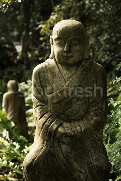 Ruined statue Ksitigarbha Bodhisattva  Stock photo © elwynn