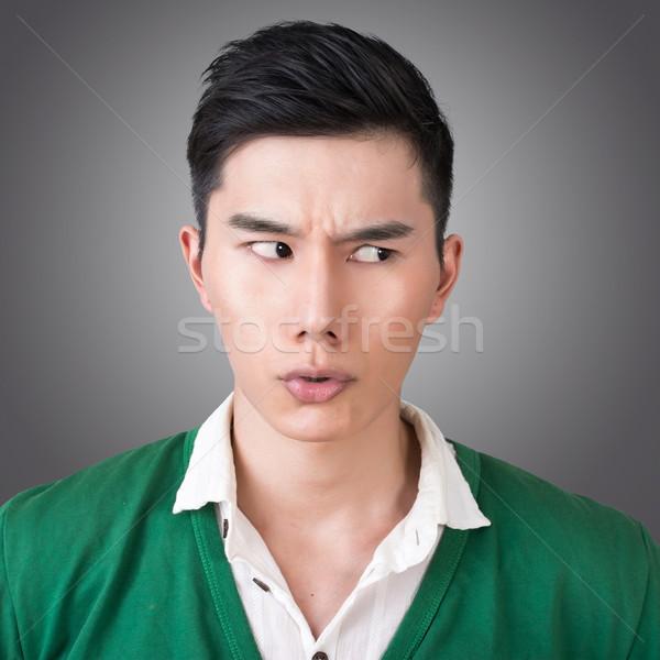 Vicces arckifejezés közelkép ázsiai fiatalember arc Stock fotó © elwynn