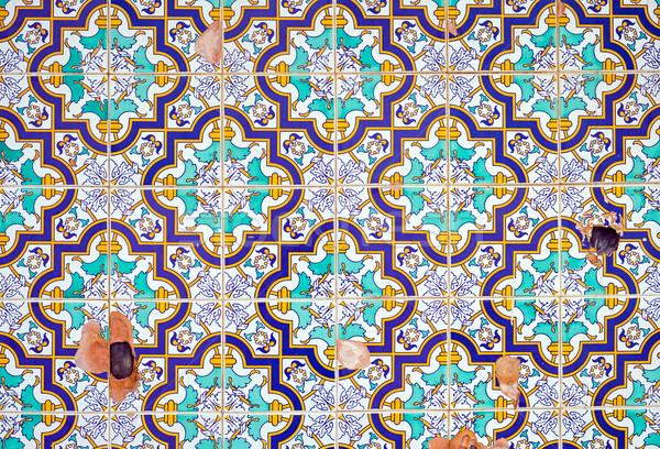 Damaged portuguese tiles Stock photo © elxeneize
