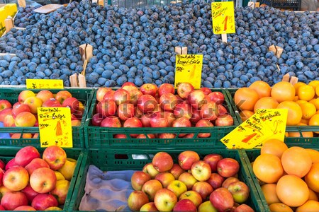 Apples, oranges and plums for sale Stock photo © elxeneize