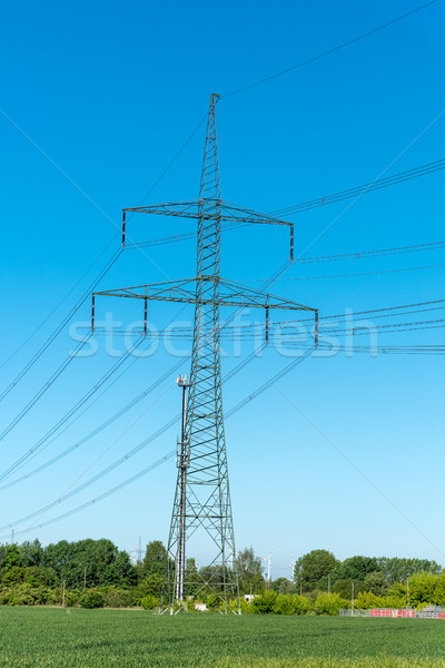 Power supply lines and electric pylons on a sunny day Stock photo © elxeneize
