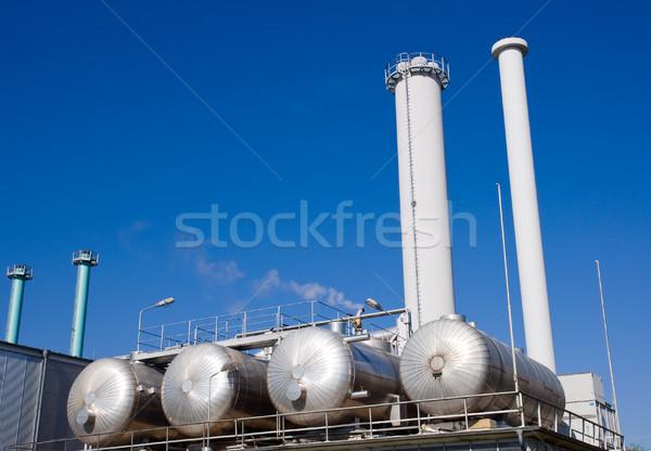 Tanks and smokestacks Stock photo © elxeneize