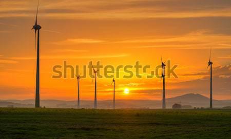 Sunset and wind engines Stock photo © elxeneize