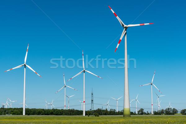 Wind energy plants on a sunny day Stock photo © elxeneize
