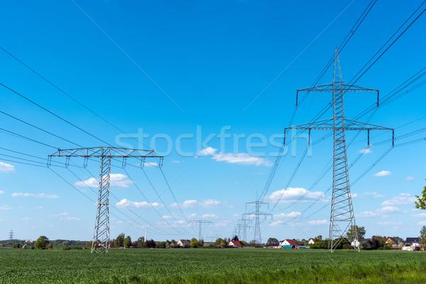 Electrical power lines Stock photo © elxeneize