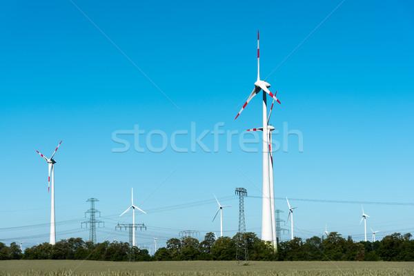Wind power plants seen in Germany Stock photo © elxeneize