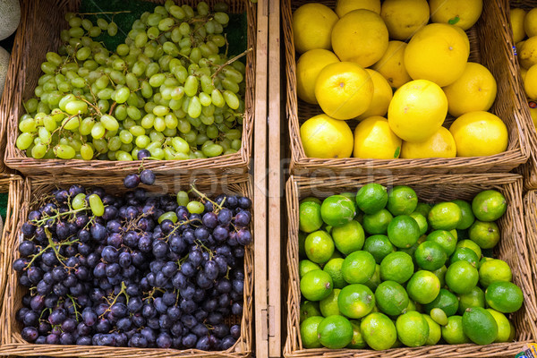 Grapefruit, grapes and limes  Stock photo © elxeneize