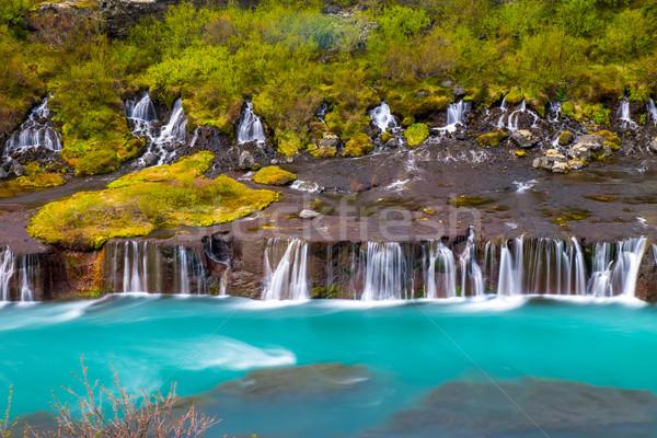 The Hraunfossar falls in Iceland Stock photo © elxeneize
