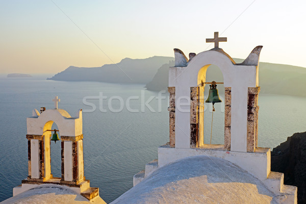 Belltowers at sunset in Oia  Stock photo © elxeneize