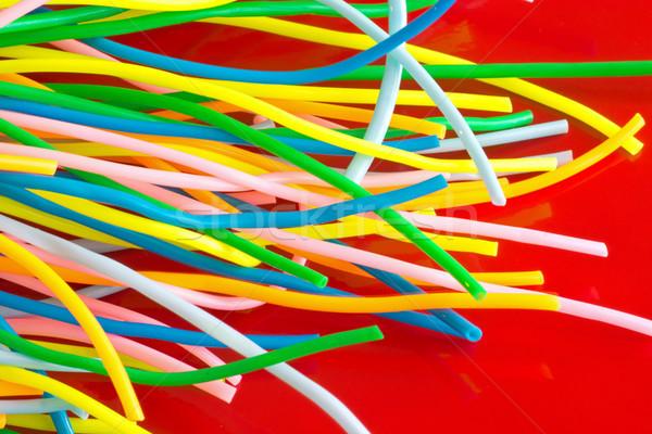 Colorato plastica cavi rosso sfondo verde Foto d'archivio © elxeneize