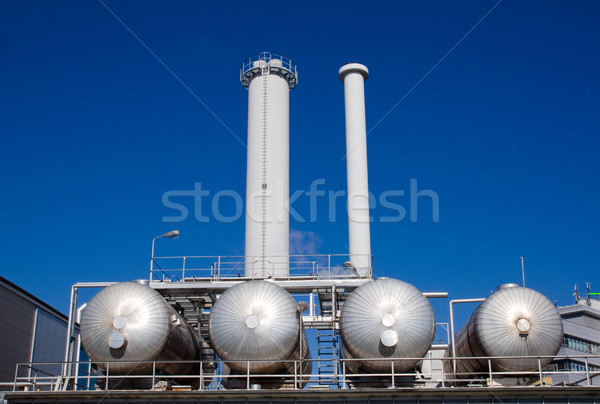 Silver tanks with smokestacks Stock photo © elxeneize