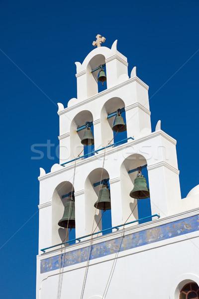 Belltower of a church in Oia  Stock photo © elxeneize