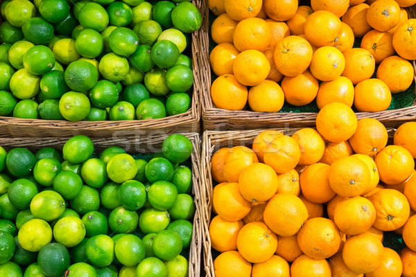Limes and oranges Stock photo © elxeneize