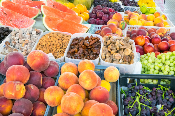 Plenty of fruit at a market Stock photo © elxeneize