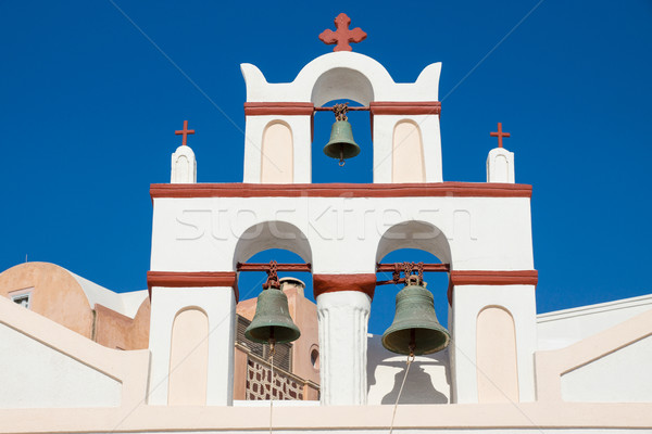 Small belltower of a church in Oia Stock photo © elxeneize