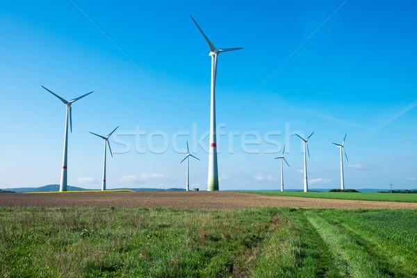 Windwheels in the fields Stock photo © elxeneize
