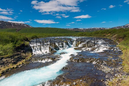 Waterval IJsland mooie turkoois water hemel Stockfoto © elxeneize