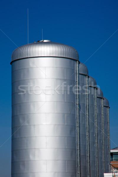 Bright silver tanks Stock photo © elxeneize