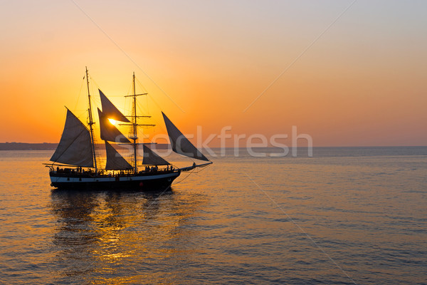 Romantic sunset with sailing ship Stock photo © elxeneize