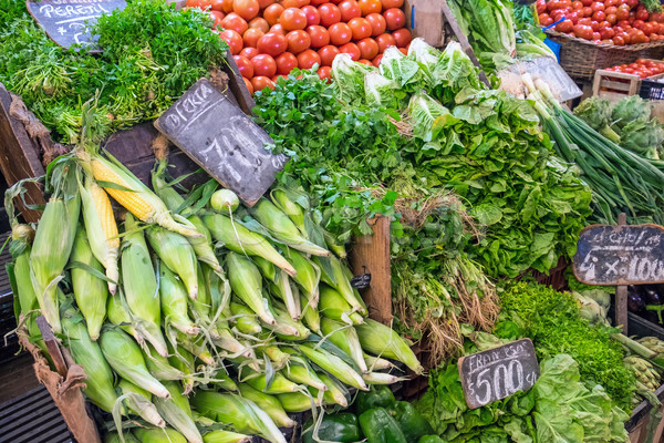 Corncob, lettuce and tomatoes for sale at a market Stock photo © elxeneize