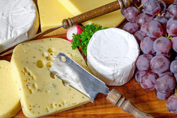 Plate of cheese and grapes Stock photo © elxeneize