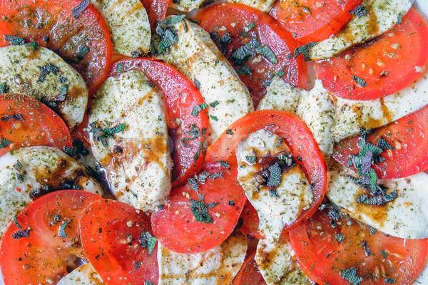 Insalata caprese pomodori mozzarella foglia rosso insalata Foto d'archivio © elxeneize