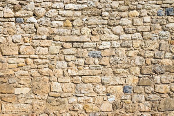 Antique natural stonewall Stock photo © elxeneize
