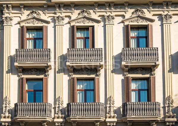 Facade with balconies in Barcelona Stock photo © elxeneize