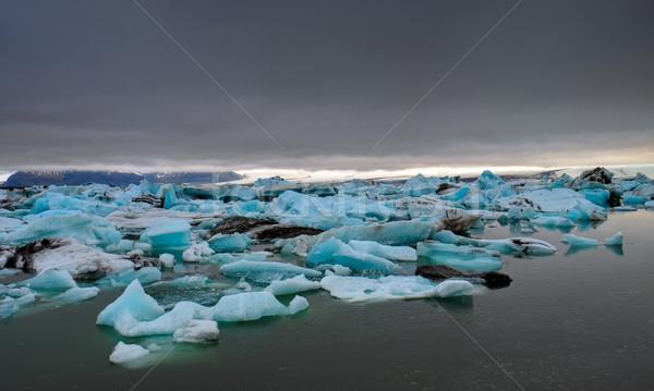 Donkere wolken gletsjer landschap zee sneeuw Stockfoto © elxeneize