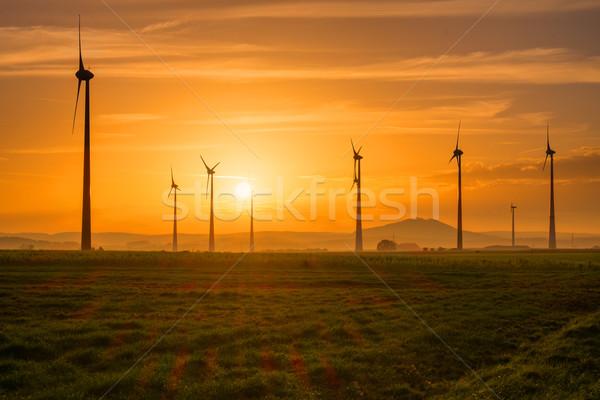 Wind engines at sunset Stock photo © elxeneize