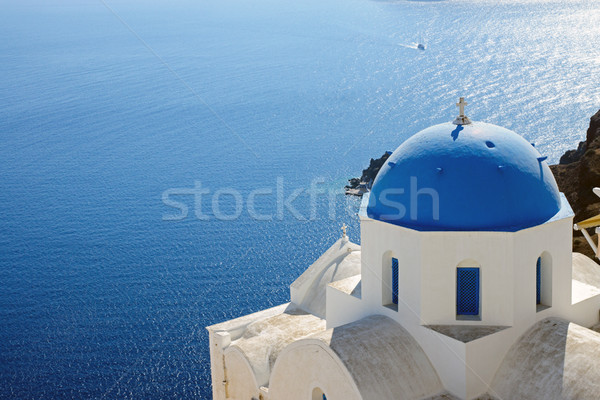 Church with blue cupola in Oia Stock photo © elxeneize