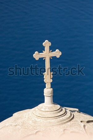 Cross high up over the sea Stock photo © elxeneize