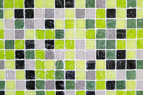 Green, black and grey mosaic tiles Stock photo © elxeneize
