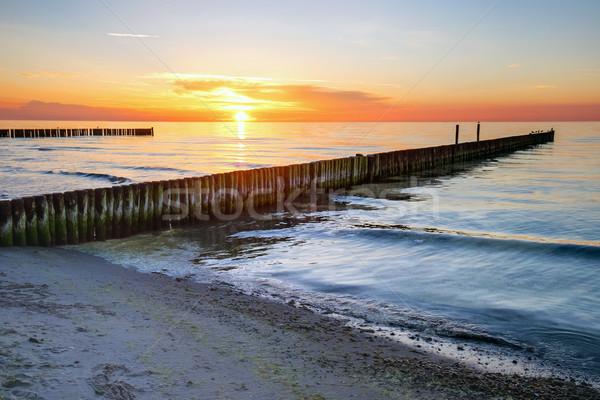 Pôr do sol mar báltico Alemanha praia céu água Foto stock © elxeneize