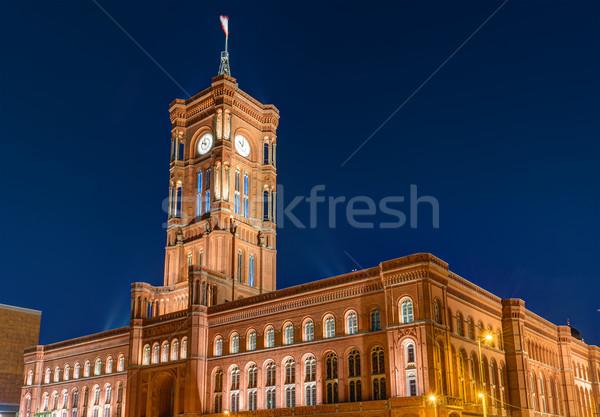 Berlin éjszaka épület óra piros torony Stock fotó © elxeneize